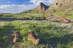 Hiking boots on trail. Hiking boots on a trail - Eagle Nest Rock Open Space in Colorado at springtime royalty free stock photos