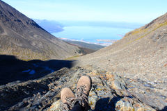 Hiking boots on a trip, look at Ushuaia - the lowest point in the world Royalty Free Stock Photo