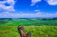 Hiking Boots, View of Patchwork Field Countryside Stock Photography