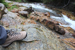 Hiking boots on the walk in the National park Royalty Free Stock Photo