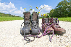 Hiking boots on a way royalty free stock images