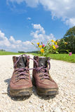 Hiking boots on a way stock image