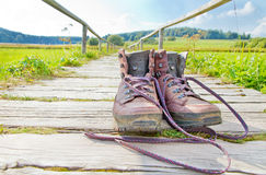Hiking boots on a way Stock Images
