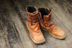 Hiking boots on wooden floor stock photos