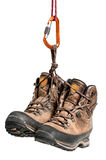 Hiking boots. Worn hiking boots, hanging from a carabiner Royalty Free Stock Photography