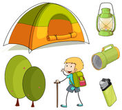 Hiking boy and camping equipments Stock Image