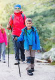 Hiking boy in the mountains Stock Images