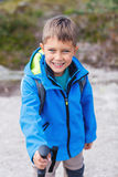 Hiking boy in the mountains Royalty Free Stock Photos