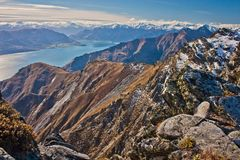 Hiking Breast Hill track in Otago region in New Zealand. Mountain view on Southern Alps of New Zealand from Breast Hill, Lake Hawea near town of Wanaka in royalty free stock photo