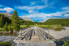 Hiking Bridge. Wooden bridge over a river on a hiking trail in the mountains Royalty Free Stock Image
