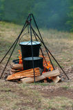 Hiking bucket and pan over the fire. With woods Royalty Free Stock Images