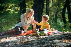 Hiking and camping. Spring mood. Happy family day. Mother love her small boy child. Family picnic. Mothers day. Sunny. Weather. Healthy food. Happy son with royalty free stock photography