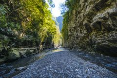 Hiking in a canyon of Bras de La Plain at Reunion Island. Hiking in a canyon during a sunny day, Bras de La Plain at Reunion Island Royalty Free Stock Image