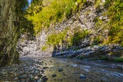 Hiking in a canyon of Bras de La Plain at Reunion Island. Hiking in a canyon during a sunny day, Bras de La Plain at Reunion Island Royalty Free Stock Photos