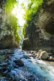 Hiking in a canyon of Bras de La Plain at Reunion Island. Hiking in a canyon during a sunny day, Bras de La Plain at Reunion Island Stock Photo