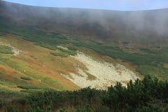 Hiking in Carpathian mountains view - clouds, ridge Royalty Free Stock Image