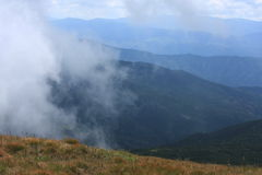 Hiking in Carpathian mountains view - clouds, ridge Royalty Free Stock Photography