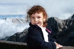 Hiking child in the Alps. Hiking child smiling in the Alps mountains Stock Photos