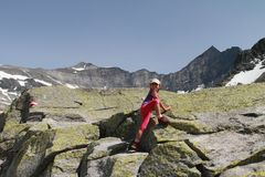 Hiking child climbing in the Alps Royalty Free Stock Photo