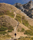 Hiking in Ciucas Mountains. A man hiking in Ciucas Mountains,Romania Royalty Free Stock Photography