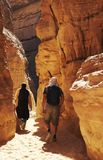 Hiking in the Colorful canyon. Two men going up along colorful canyon in Egypt Royalty Free Stock Images