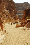 Hiking in the Colorful canyon. Group going up along colorful canyon in Egypt Royalty Free Stock Images