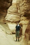 Hiking in Colorful canyon. Man going in  colorful canyon in Egypt Stock Photos