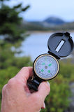 Hiking Compass. Determining location with a compass Stock Image
