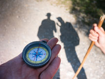 Hiking with compass Stock Images