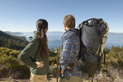 Hiking Couple On Coastal Track Looking At View Stock Photo