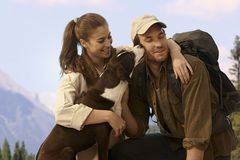 Hiking couple with dog Royalty Free Stock Image