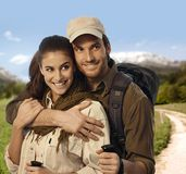 Hiking couple embracing in countryside Royalty Free Stock Images