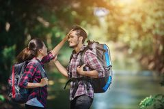 Hiking couple in forest together. Adventure travel vacation. Hap royalty free stock photos