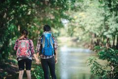 Hiking couple in forest together. Adventure travel vacation. Hap royalty free stock photo