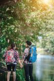 Hiking couple in forest together. Adventure travel vacation. Hap royalty free stock photography