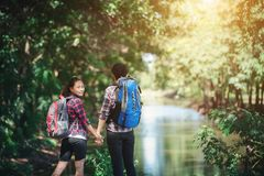 Hiking couple in forest together. Adventure travel vacation. Hap royalty free stock images