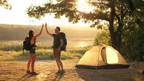 Hiking couple giving five. Hiking people on nature giving high five stock video footage