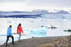 Hiking couple on Iceland Jokulsarlon glacier lake Stock Photo