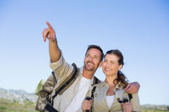 Hiking couple pointing and looking in the countryside Royalty Free Stock Photography