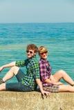 Hiking couple relaxing on sea coast Stock Image