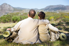Hiking couple sitting and admiring the scenery Royalty Free Stock Photo