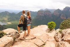 Hiking couple standing at edge of mountain