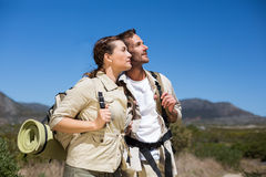 Hiking couple standing and looking on country terrain Royalty Free Stock Photos