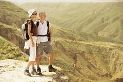 Hiking Couple Standing On Top Of Mountain Stock Image