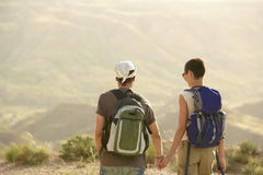 Hiking Couple On Top Of Mountain Stock Photos