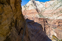 Hiking Dangerous Trails at Zion National Park. Hiking the Hidden Canyon trail at Zion National Park in Utah stock photo
