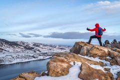 Hiking at dawn over frozen mountain lake Royalty Free Stock Image