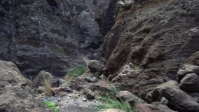 Hiking in a deep gorge stock video