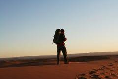 Hiking in desert Stock Images