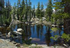 Hiking In Desolation Wilderness Near Lake Tahoe. A small lake along a hiking trail in Desolation Wilderness near Lake Tahoe, California royalty free stock photo